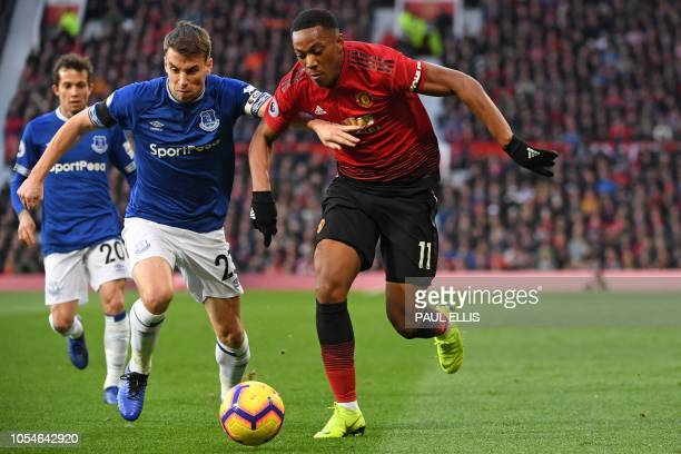 Manchester United's French striker Anthony Martial vies with Everton's Irish defender Seamus Coleman during the English Premier League football match...