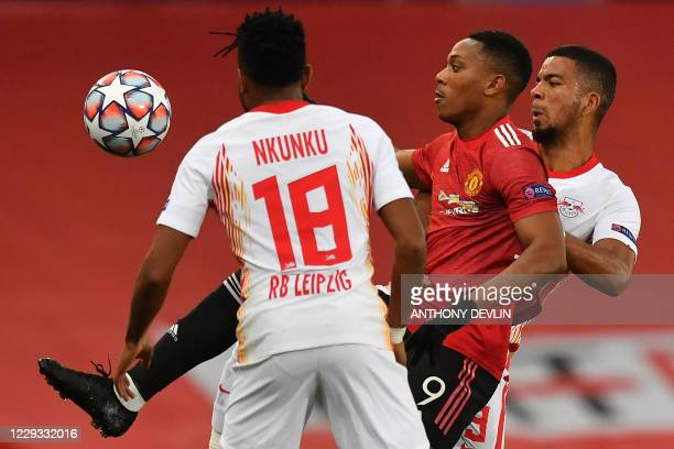 Manchester United's French striker Anthony Martial vies with RB Leipzig's French midfielder Christopher Nkunku and RB Leipzig's German defender...