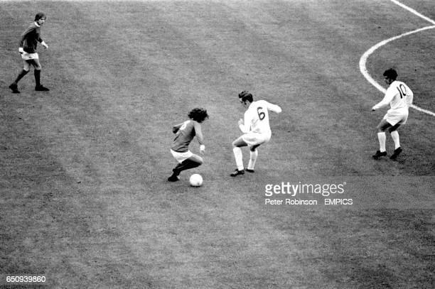 Manchester United's George Best takes on Leeds United's Paul Madeley watched by teammate John Fitzpatrick and Leeds United's Mick Bates