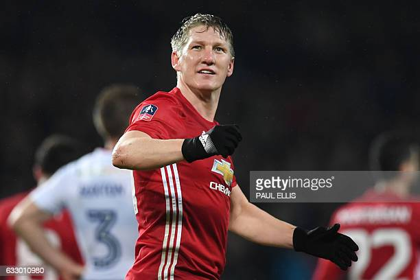 Manchester United's German midfielder Bastian Schweinsteiger celebrates scoring their fourth goal during the English FA Cup fourth round football...