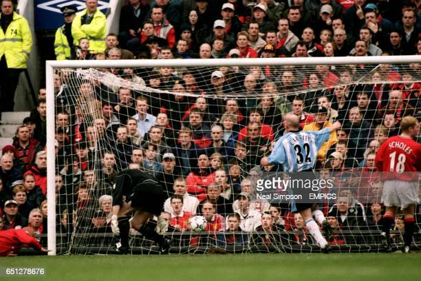 Manchester United's goalkeeper Andy Goram fails to save Coventry City's second goal scored by John Hartson