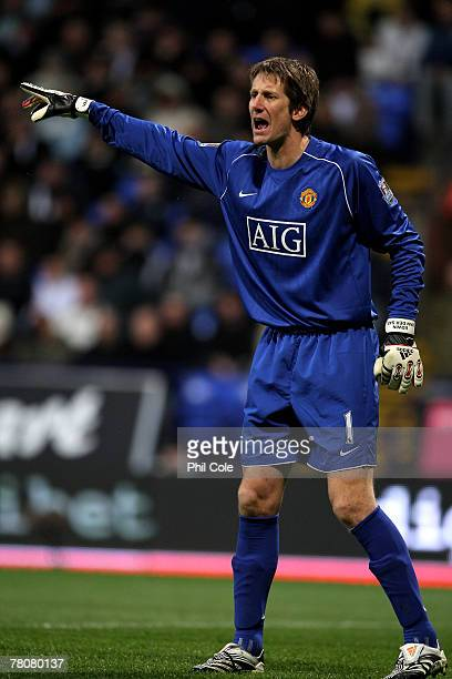 Manchester United's goalkeeper Edwin van der Sar gestures instructions during the Barclays Premier League match between Bolton Wanderers and...