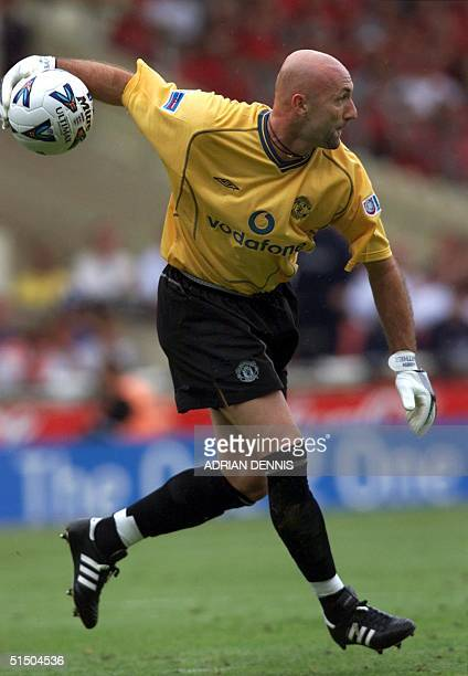 Manchester United's goalkeeper Fabien Barthez their new summer signing throws the ball out during the second half of the FA Charity Shield at Wembley...