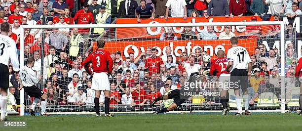 Manchester United's goalkeeper Tim Howard can't quite reach the ball as Liverpool's Danny Murphy scores from the spot to make it 10 during their...