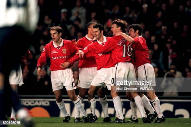 Manchester United's goalscorers Ryan Giggs and Teddy Sheringham celebrate with teammates Phil Neville Mickael Silvestre and Denis Irwin