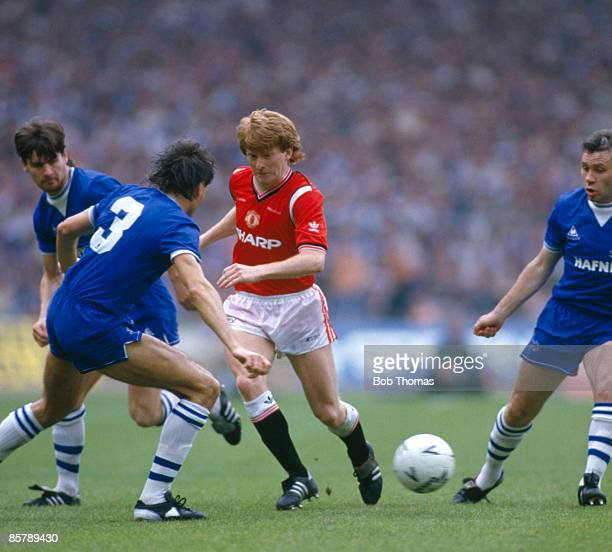 Manchester United's Gordon Strachan is surrounded by Everton's Paul Bracewell Pat Van Den Hauwe and Peter Reid during the FA Cup Final at Wembley...
