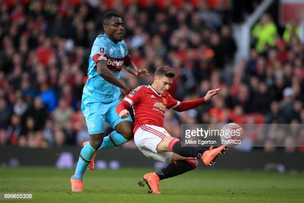 Manchester United's Gullermo Varela and West Ham United's Emmanuel Emenike battle for the ball