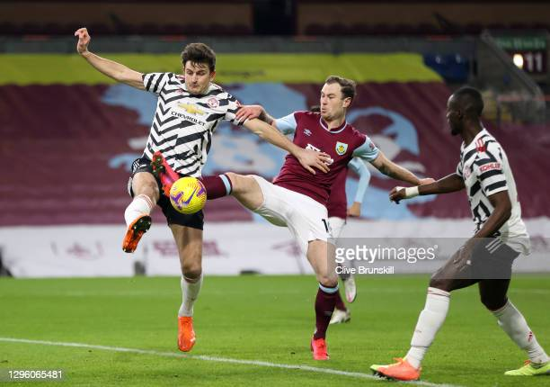 Manchester United's Harry Maguire in action with Burnley's Ashley Barnes during the Premier League match between Burnley and Manchester United at...