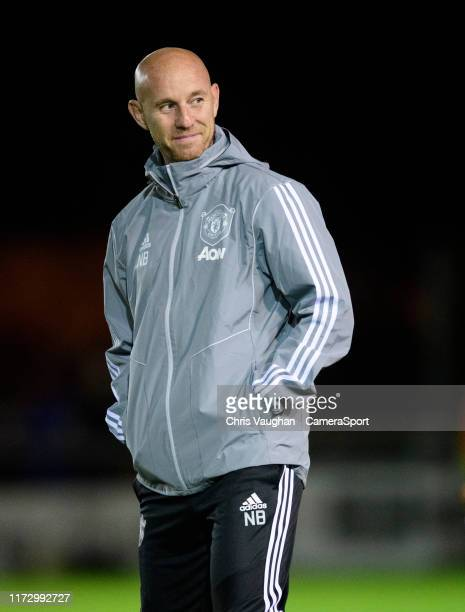 Manchester Uniteds head of first team development Nicky Butt during the prematch warmup prior to the EFL Leasingcom Trophy Northern Section Group H...