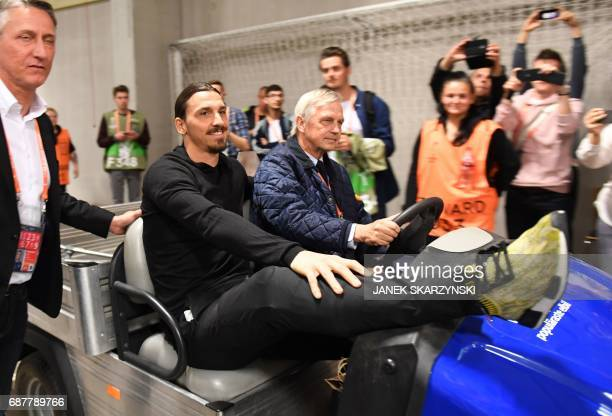 TOPSHOT Manchester United's injured Swedish striker Zlatan Ibrahimovic arrives to watch the UEFA Europa League final football match Ajax Amsterdam v...