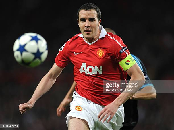 Manchester United's Irish defender John O'Shea eyes the ball during the UEFA Champions League semifinal second leg football match between Manchester...