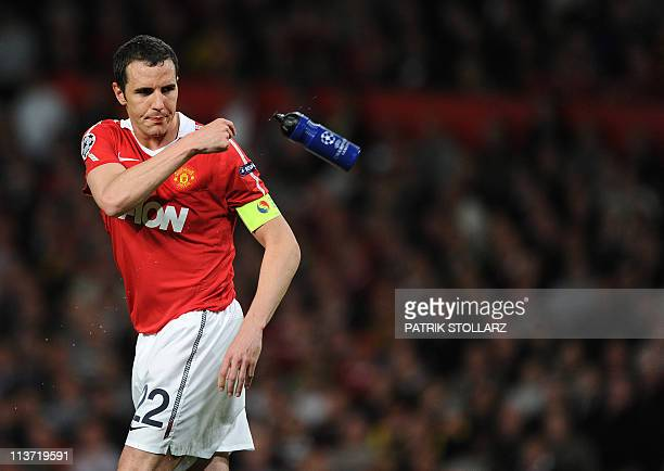Manchester United's Irish defender John O'Shea reacts during the UEFA Champions League semifinal second leg football match between Manchester United...