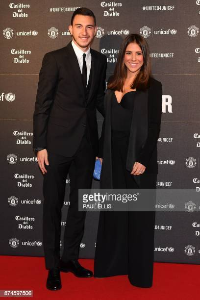 Manchester United's Italian defender Matteo Darmian and Francessca Darmian pose on the red carpet as they arrive to attend the 'United for UNICEF...