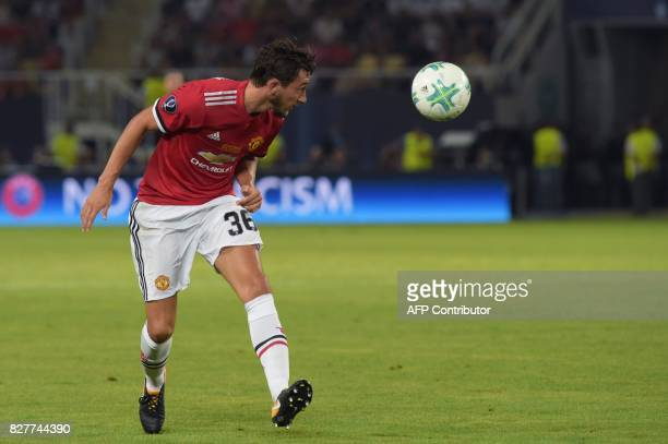 Manchester United's Italian defender Matteo Darmian heads the ball during the UEFA Super Cup football match between Real Madrid and Manchester United...