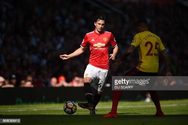 Manchester United's Italian defender Matteo Darmian players the ball around Watford's Germanborn Greek midfielder José Holebas during the English...