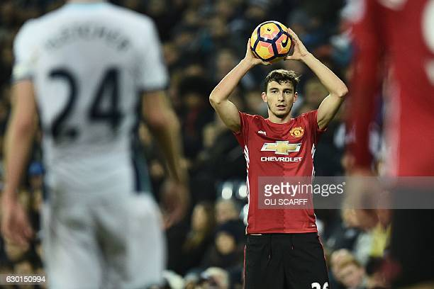 Manchester United's Italian defender Matteo Darmian prepares to take a throwin during the English Premier League football match between West Bromwich...