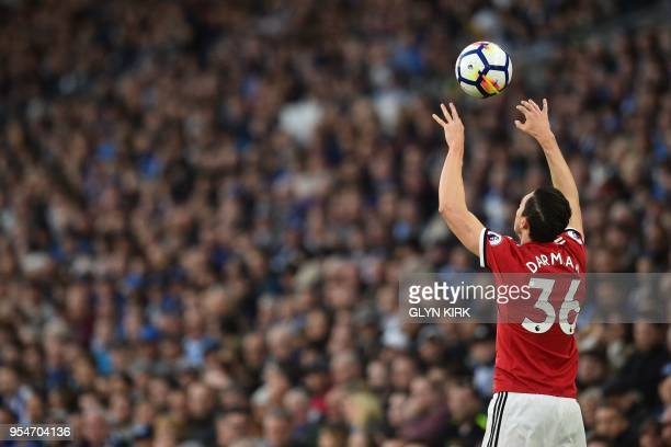 Manchester United's Italian defender Matteo Darmian takes a throwin during the English Premier League football match between Brighton and Hove Albion...