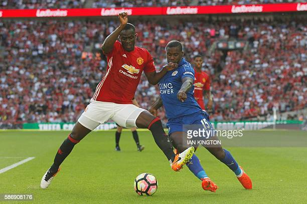 Manchester United's Ivorian defender Eric Bailly challenges Leicester City's Ghanaian striker Jeff Schlupp during the FA Community Shield football...