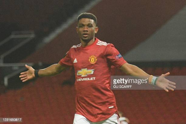 Manchester United's Ivorian midfielder Amad Diallo celebrates scoring the opening goal during the UEFA Europa League round of 16 first leg football...
