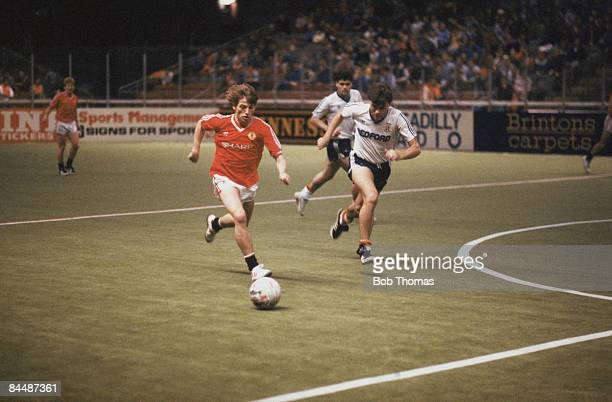 Manchester United's Jesper Olsen races away from Mal Donaghy of Luton Town FC during the Guinness Soccer Six Championships at the GMEX centre...