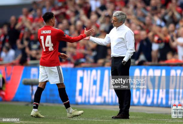 Manchester United's Jesse Lingard and manager Jose Mourinho shake hands during the Emirates FA Cup semifinal match at Wembley Stadium London