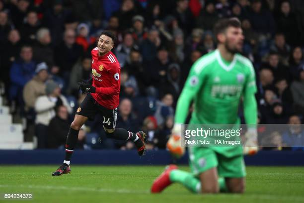 Manchester United's Jesse Lingard celebrates after scoring his side's first goal of the game while West Bromwich Albion goalkeeper Ben Foster looks...