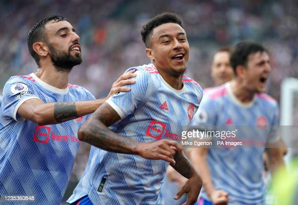Manchester United's Jesse Lingard celebrates scoring their side's second goal of the game with team-mates Bruno Fernandes and Harry Maguire during...