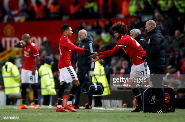 Manchester United's Jesse Lingard is replaced by Marouane Fellaini during the Emirates FA Cup quarter final match at Old Trafford Manchester