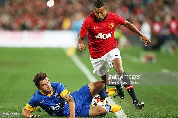 Manchester United's Jesse Lingard is tackled by ALeauge All Stars Josh Risdon at Stadium Australia Sydney Australia Saturday 20th July 2013