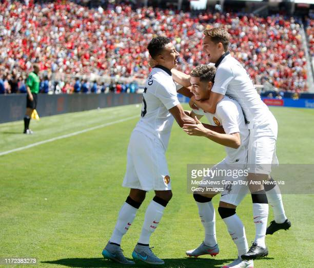 Manchester United's Jesse Lingard left celebrates a 20 goal with Andreas Pereira and Adnan Januzaj against FC Barcelona in the second half during the...