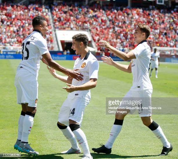 Manchester United's Jesse Lingard on left celebrates a 20 goal with Andreas Pereira and Adnan Januzaj against FC Barcelona in the second half during...