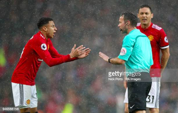 Manchester United's Jesse Lingard speaks with referee Paul Tierney during the Premier League match at Old Trafford Manchester