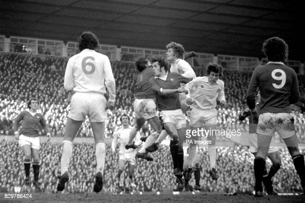 Manchester United's Jim Holton beats Leeds United's Trevor Cherry Gordon McQueen and David Harvey to the ball but heads over the bar watched by...