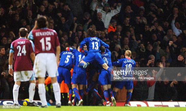 Manchester United's John O'Shea is congratulated after scoring against West Ham United during the Barclays Premiership match at Upton Park London...