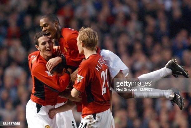Manchester United's John O'Shea Quinton Fortune and Darren Fletcher congratulate Roy Keane on scoring their third goal