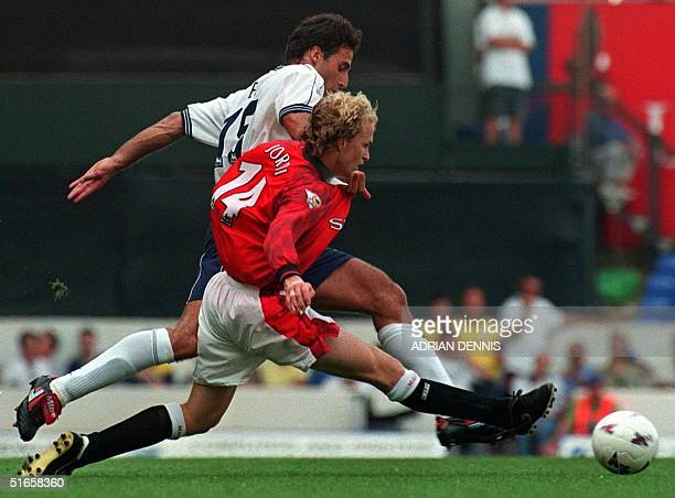 Manchester United's Jordi Cruyff and Tottenham Hotspur's Ramon Vega fight for the ball during the match at White Hart Lane in London 10 August...