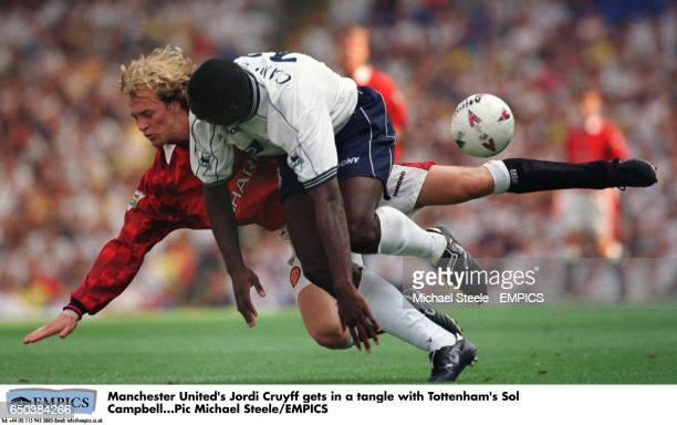 Manchester United's Jordi Cruyff gets in a tangle with Tottenham's Sol Campbell