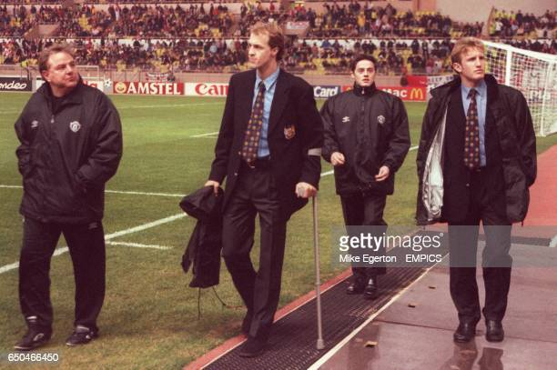 Manchester United's Jordi Cruyff walks to the bench on crutches