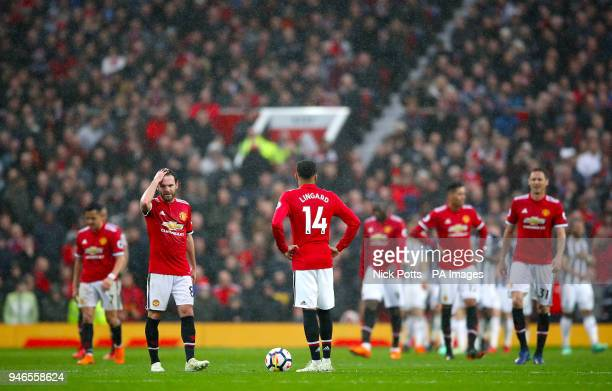 Manchester United's Juan Mata and Manchester United's Jesse Lingard show their dejection after their side concede during the Premier League match at...