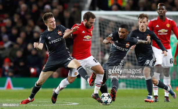 Manchester United's Juan Mata in action with CSKA Moscow's Alexandr Golovin and Coelho Vitinho during the UEFA Champions League match at Old Trafford...