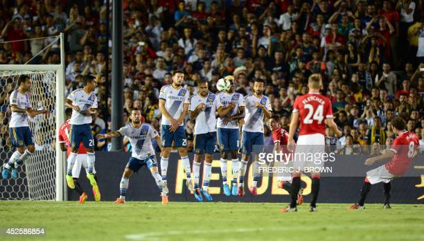 Manchester United's Juan Mata takes a freekick against the LA Galaxy wall during their Chevrolet Cup match at the Rose Bowl in Pasadena California on...