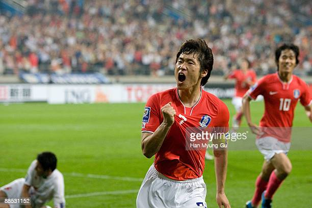 Manchester United's Korean midfielder Park JiSung of South Korea reels off celebrating a goal scored during the 2010 FIFA World Cup Asian Qualifiers...