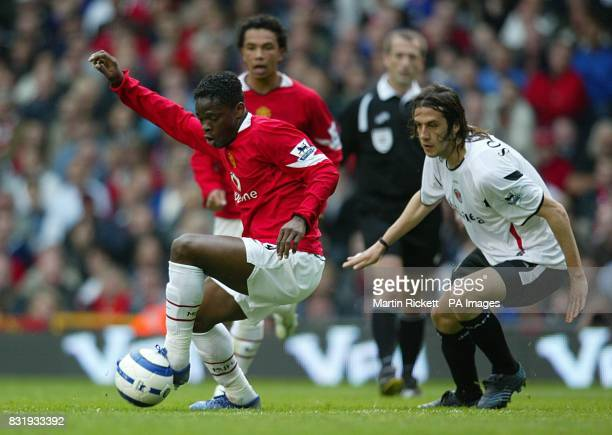 Manchester United's Louis Saha is watched by Charlton Athletic's Gonzalo Sorondo