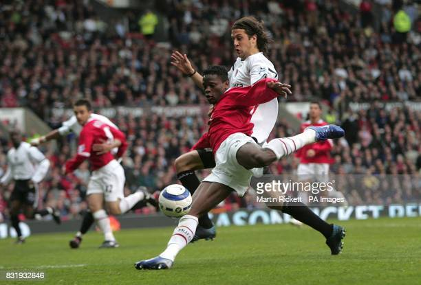 Manchester United's Louis Saha shoots at goal under pressure from Charlton Athletic's Gonzalo Sorondo