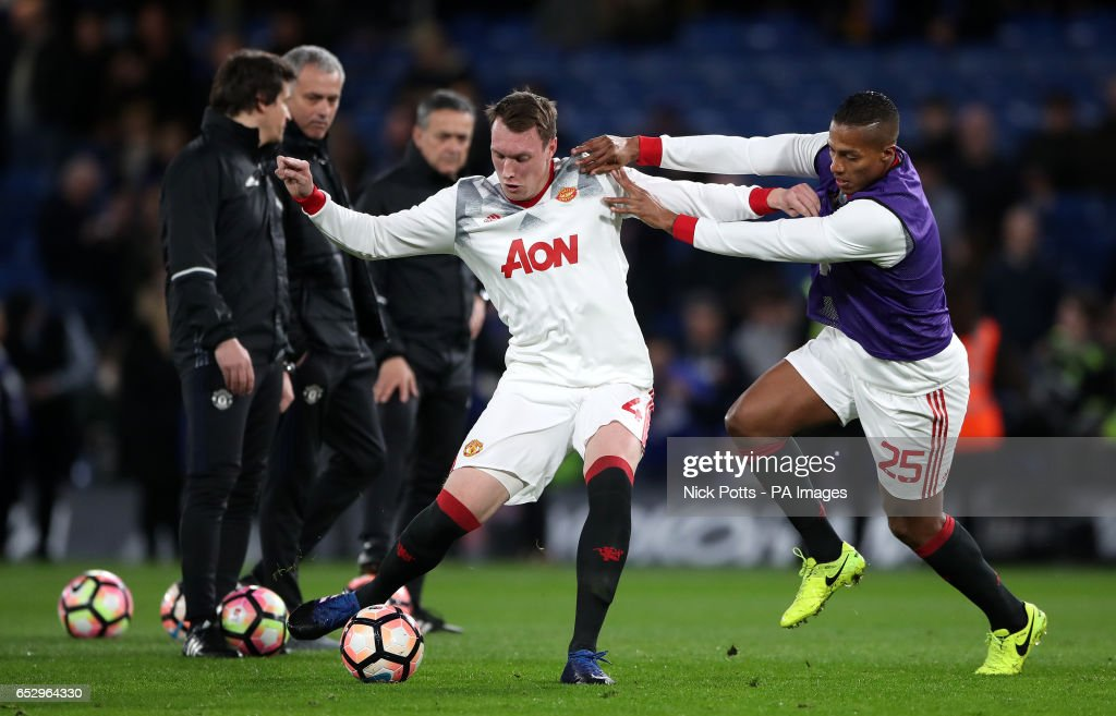 Manchester United's Luis Antonio Valencia (right) and Phil Jones during the warm up for the Emirates FA Cup, Quarter Final match at Stamford Bridge, London.