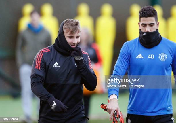 Manchester United's Luke Shaw and goalkeeper Joel Castro Pereira during the training session at the AON Training Complex Carrington