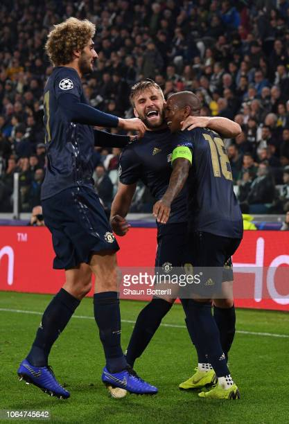 Manchester United's Luke Shaw celebrates with captain Ashley Young and Marouane Fellaini after the second goal during the UEFA Champions League Group...