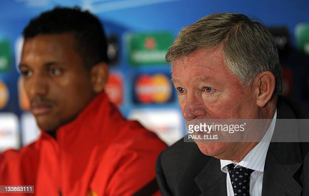 Manchester United's manager Alex Ferguson and Portuguese midfielder Nani speaks give a press conference at Old Trafford in Manchester northwest...