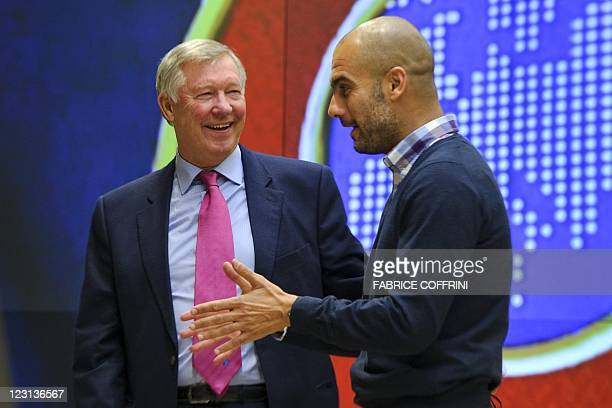 Manchester United's manager Alex Ferguson speaks with Barcelona's coach Josep Guardiolaafter a family picture on August 31 2011 in Nyon during the...