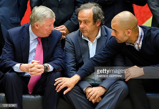 Manchester United's manager Alex Ferguson UEFA president Michel Platini and Barcelona's coach Josep Guardiola speak together during a family picture...